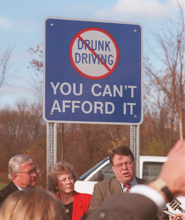 Description of . Oakland County Executive L. Brooks Patterson, Troy Mayor Jeanne Stein and David Easterbrook, address the crowd as they unvail the first of two dozen signs throughout the county warning about drinking and driving.  The sign is at the corner of Crooks and Long Lake in Troy.  Eaterbrooks daughter Ashley was killed by a drunk driver there.