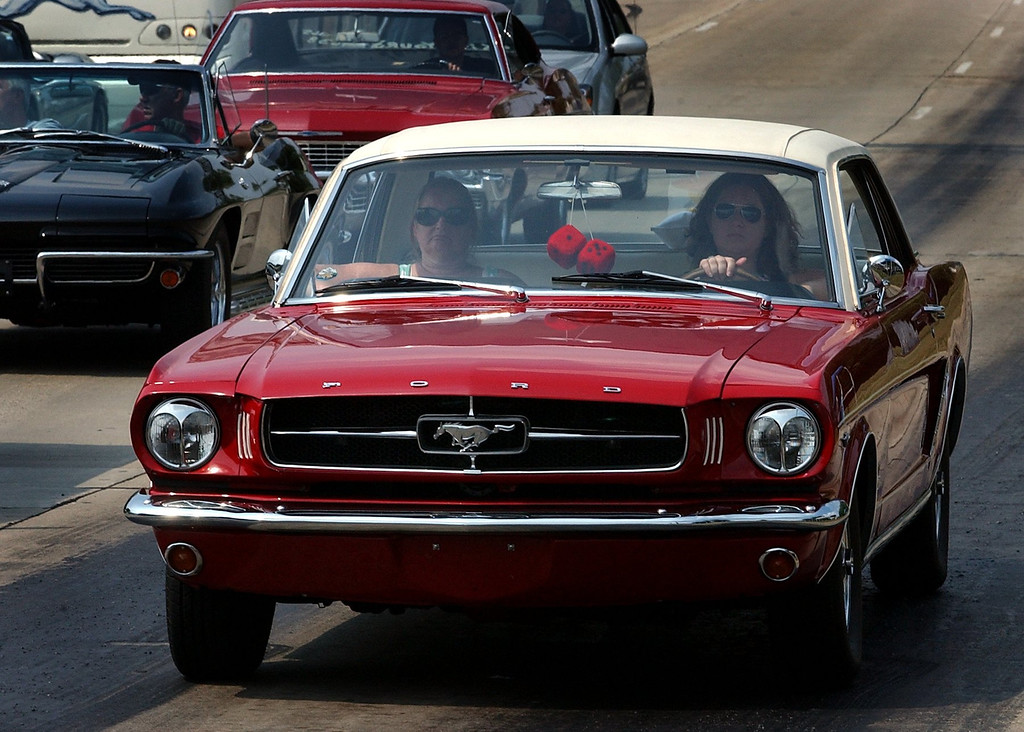 Description of . (left) Rose and Sara Bejma, of Oxford, cruise along Woodward Avenue in Pontiac, in a 1965 Ford Mustang.(Oakland Press Photo/Vaughn Gurganian)