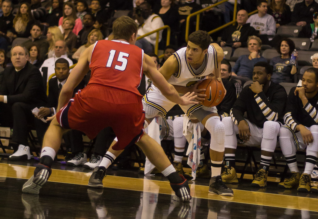 Description of . Williams keeps the ball from the opposing UIC defender. Photos by Dylan Dulberg/The Oakland Press