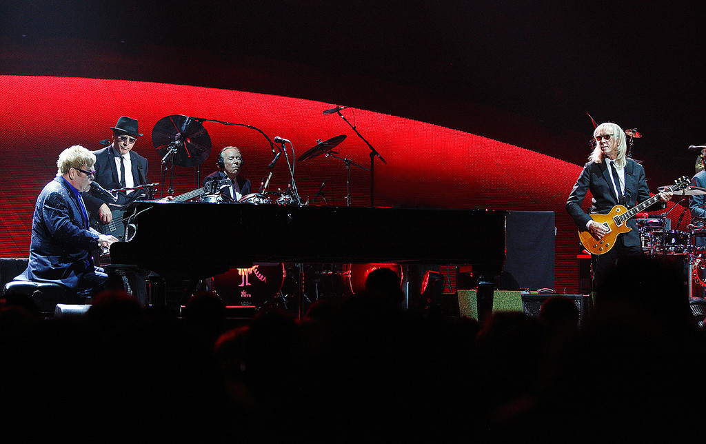 Description of . Elton John and his band at Joe Louis Arena on Friday night. Photo by Ken Settle