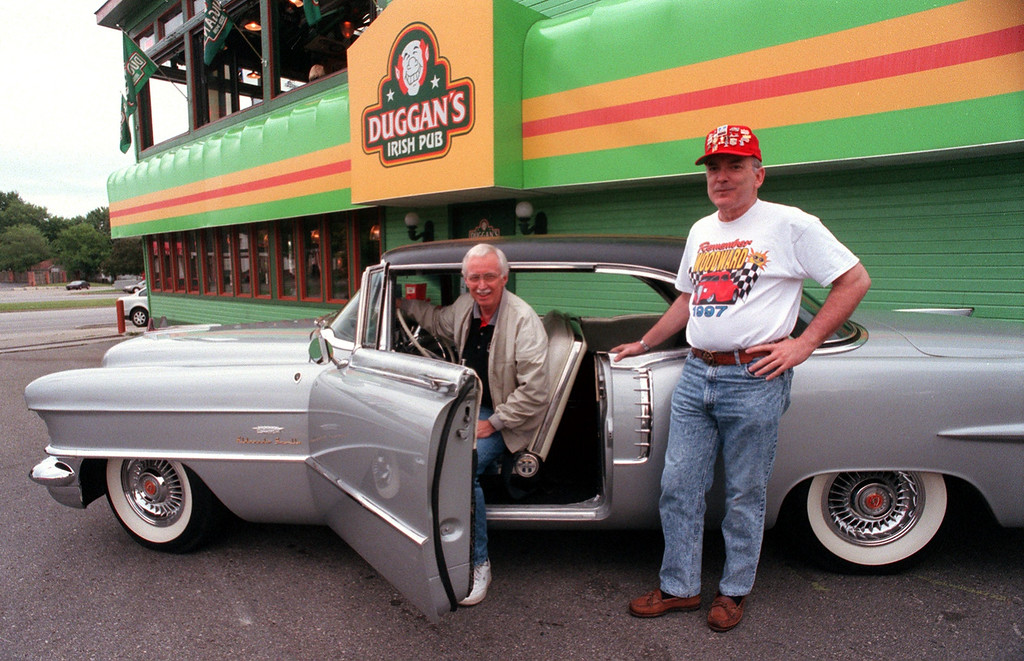 """Description of . Stan Spindler (left) and Don Schieltz both of Rochester Hills have produced a CD with original Woodward Dream Cruise music entitled \""""Stan Spindler and the Dualtones.\"""" They are seen here with 56\' Eldorado Seville outside Duggan\'s Pub in Royal Oak."""