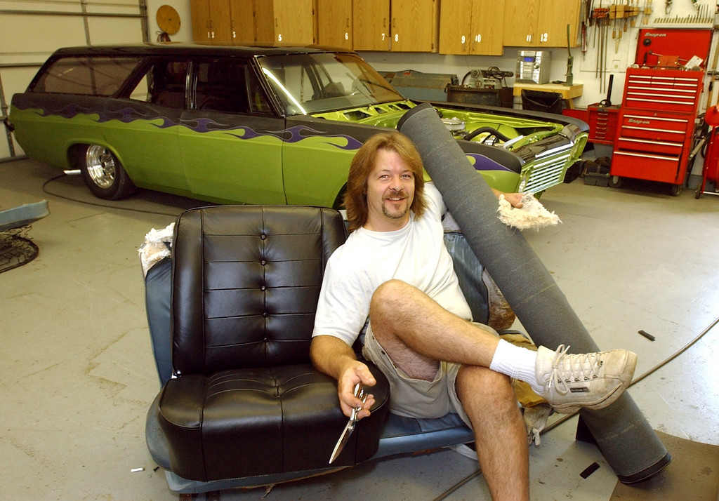 Description of . Carl Claus, of Carl\'s Auto Interior in Waterford, does a lot of custom seat upholstering for many cars that take part in the Woodward Dream Cruise, pictured Thursday August 18, 2005.