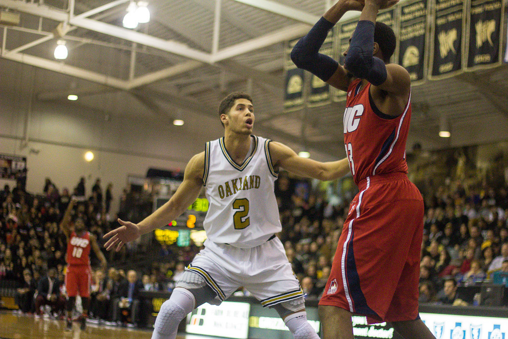 Description of . Williams attempts to defend his UIC opponent. Photos by Dylan Dulberg/The Oakland Press