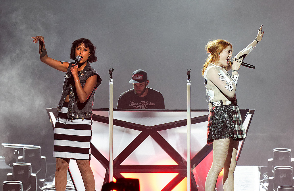 Description of . Caroline Hjelt and Aino Jawo of Icona Pop perform in support of Miley Cyrus at The Palace of Auburn Hills on April 12, 2014. Photo by Ken Settle