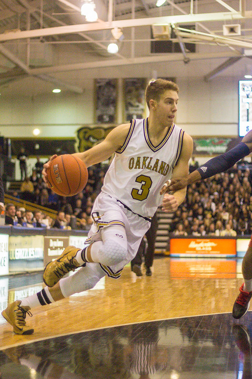 Description of . Bader rushes toward the basket. Photos by Dylan Dulberg/The Oakland Press