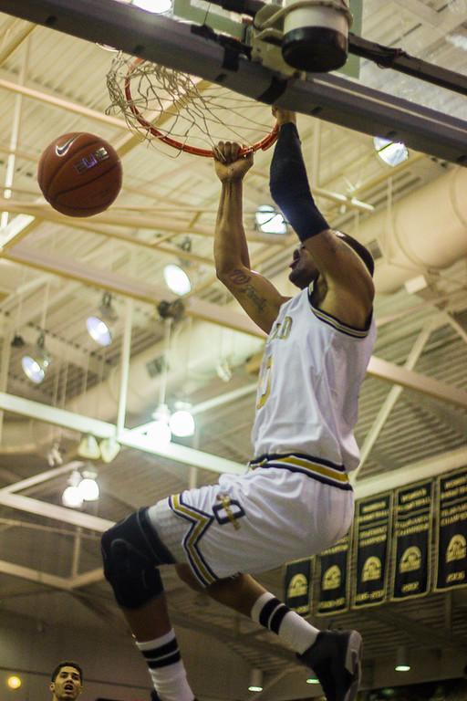 Description of . Mondy gets a slam dunk. Photos by Dylan Dulberg/The Oakland Press