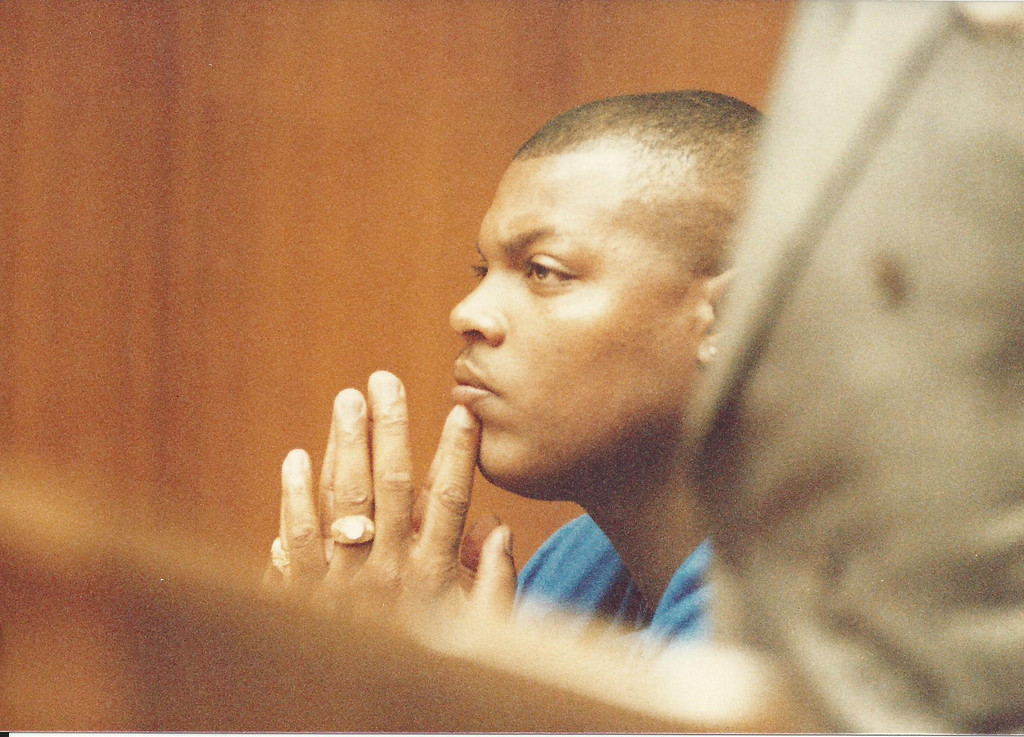 Description of . Former Detroit Lions player Reggie Rogers in Oakland County Circuit Court in August 1989. The Oakland Press/file photo