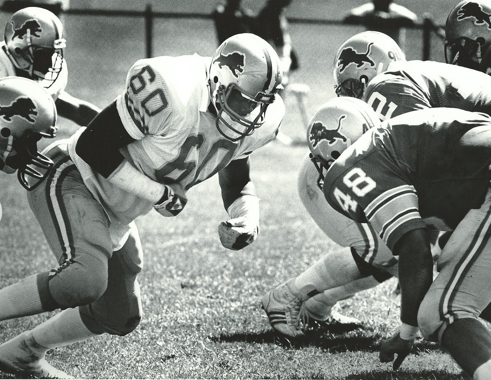 Description of . Former Lions player Reggie Rogers practices with the team in July 1987. Oakland Press file photo