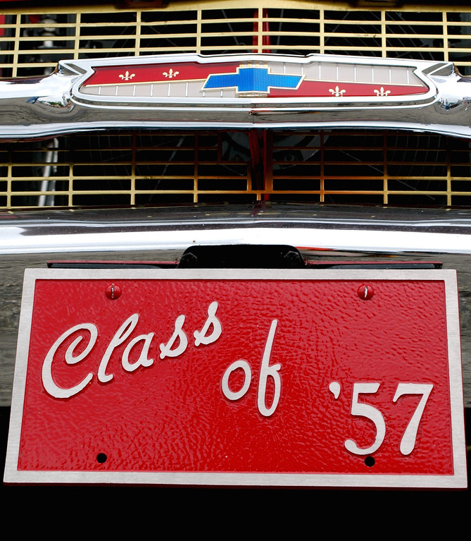 . The grill and fron plate of a 1957 Chevy Bel Air owned by John and Peggy Sieffert of Troy.  John bought the Bel Air, seen Saturday in downtown Pontiac during the Woodward Dream Cruise, since he graduated high school in 1957 also.