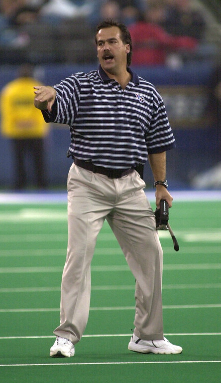 . Tennessee Titans Head Coach Jeff Fisher directs his team during a 27-24 victory over the Detroit Lions Sunday, October 21, 2001 at the Pontiac Silverdome.