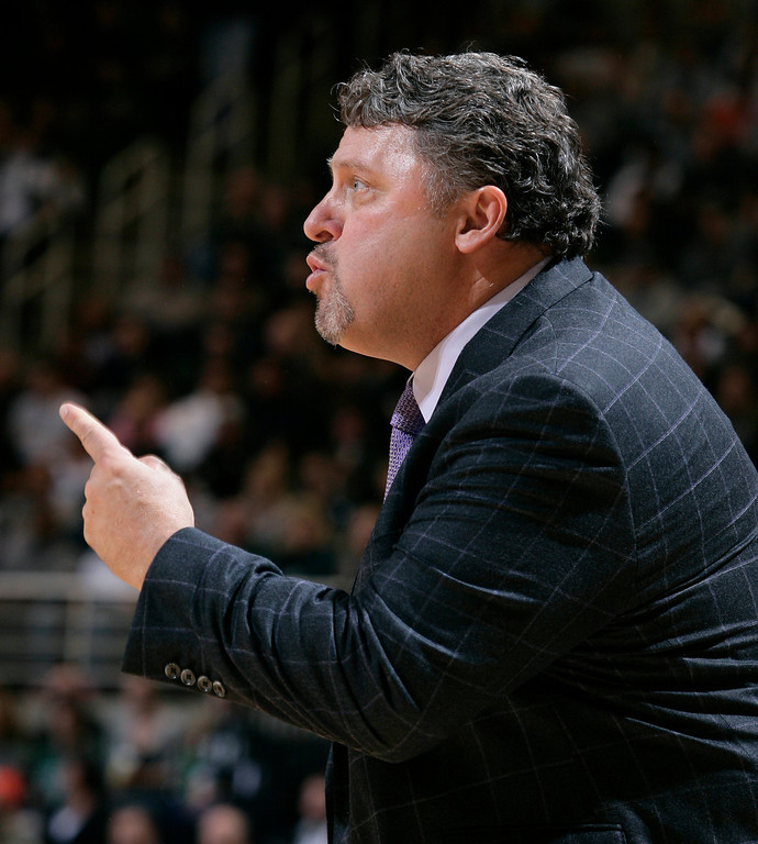 Description of . Oakland coach Greg Kampe gives instructions during the first half of an NCAA college basketball game against Michigan State, Friday, Nov. 23, 2012, in East Lansing, Mich. Michigan State won 70-52. (AP Photo/Al Goldis)