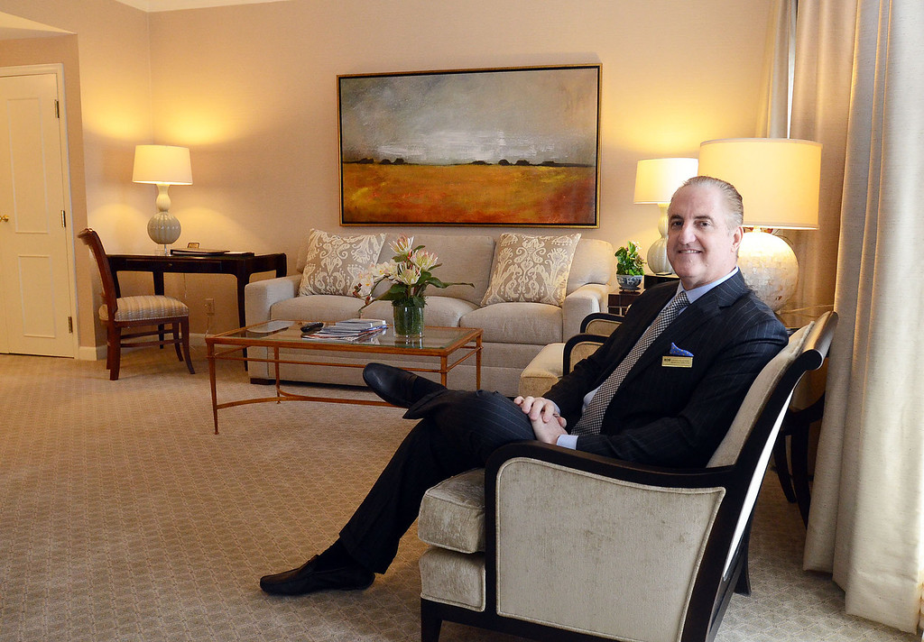 Description of . Steven Kalczynski, Managing Director, in one of the renovated suites at The Townsend Hotel in Birmingham, pictured Monday March 24, 2014. (Vaughn Gurganian-The Oakland Press)