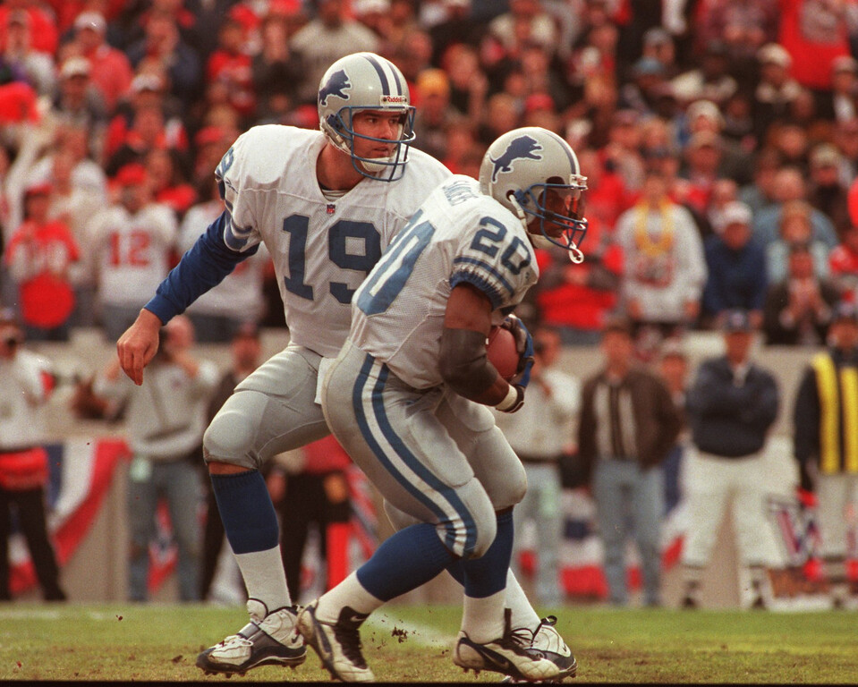 . Lions QB Scott Mitchell hands off to running back Barry Sanders in first half of play during the playoff game verses the Tampa Bay Buccaneers . Detroit lost in the first round play 20-10.