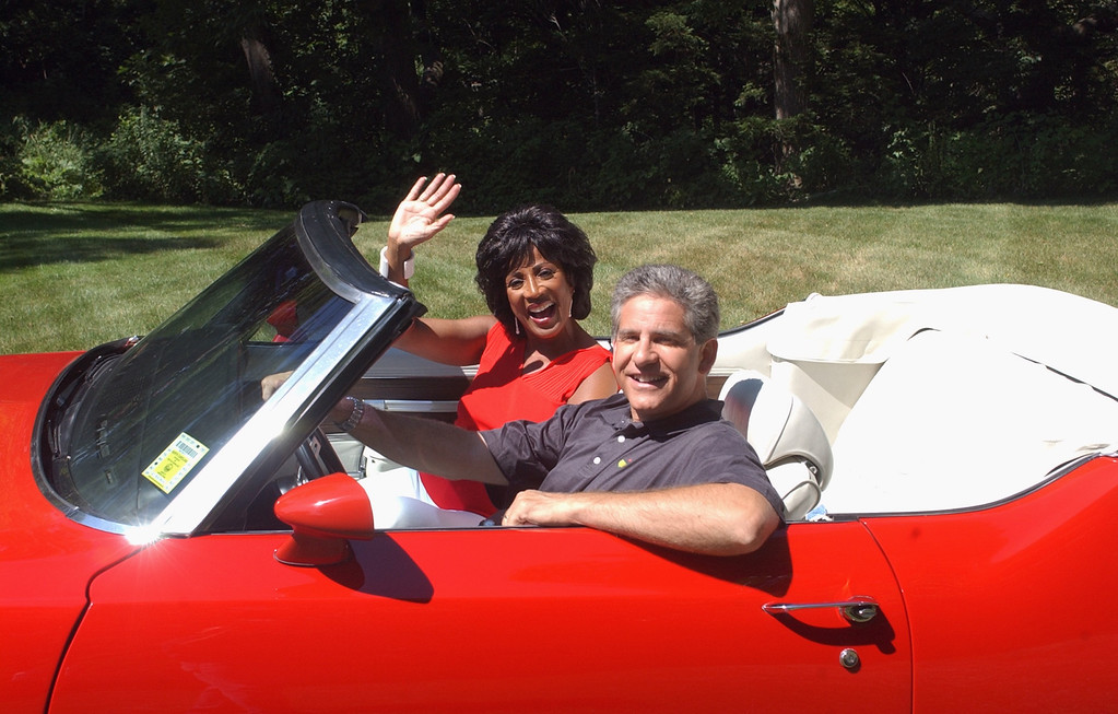 . Diane Lewis and Guy Gordon from WXYZ-TV/channel 7 stand with a classic Oldsmobile for this year\'s  9th annual Woodward Dream Cruise.
