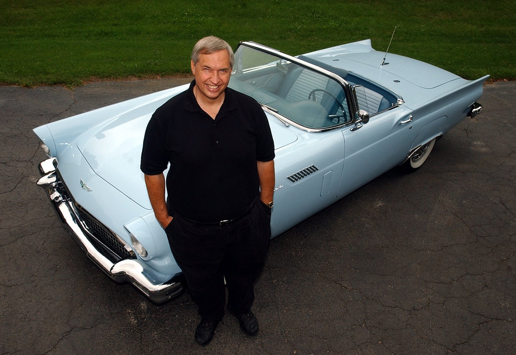 Description of . Dave Campbell, of Oxford, next to his 1957 Ford Thunderbird he'll be driving during the Woodward Dream Cruise. (Oakland Press Photo: Vaughn Gurganian)