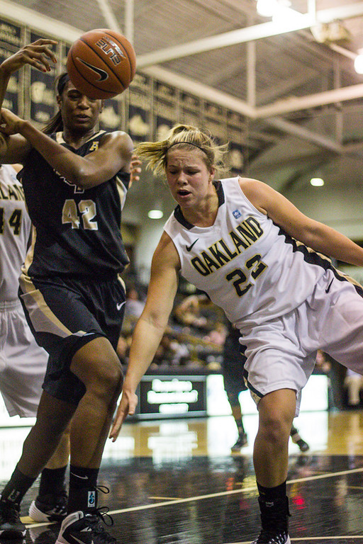 Description of . Apsey is fouled by a UCF player. Photo by Dylan Dulberg