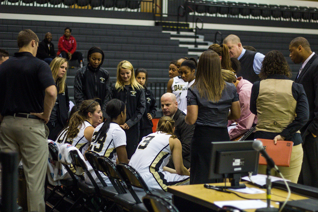 Description of . The team meets during a time out in the first half. Photo by Dylan Dulberg