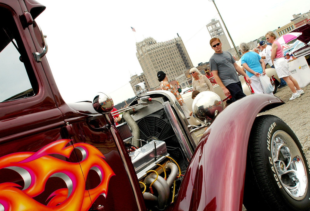 Description of . Enthusiasts check out cars during the Woodward Dream Cruise, including this 1931 Ford Coupe parked in Pontiac Saturday.