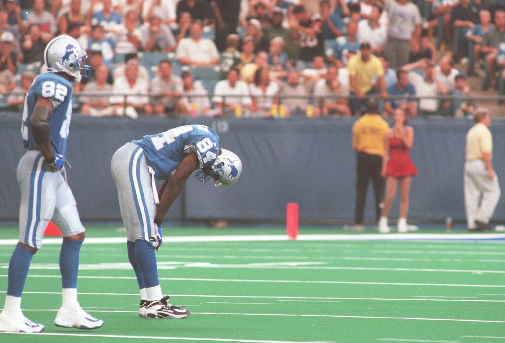 . Detroit Lions Germane Crowell (82) and Herman Moore (84) walk off the field at the end of the game  during Sunday\'s game played against the Cincinnati Bengals at the Pontiac Silverdome. Lions lost 34- 28 in overtime.