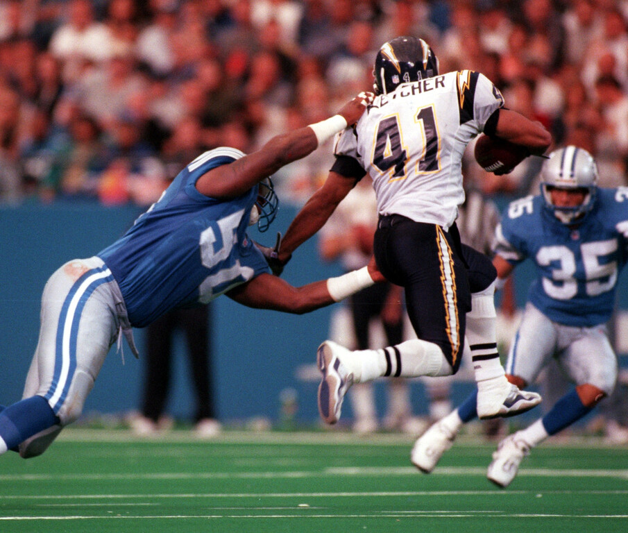 . Detroit Lions linebacker Chris Claiborne (left, #50) prepares to tackle San Diego Chargers running back Terrell Fletcher (#41) during third quarter action, Sunday, October 10, 1999.