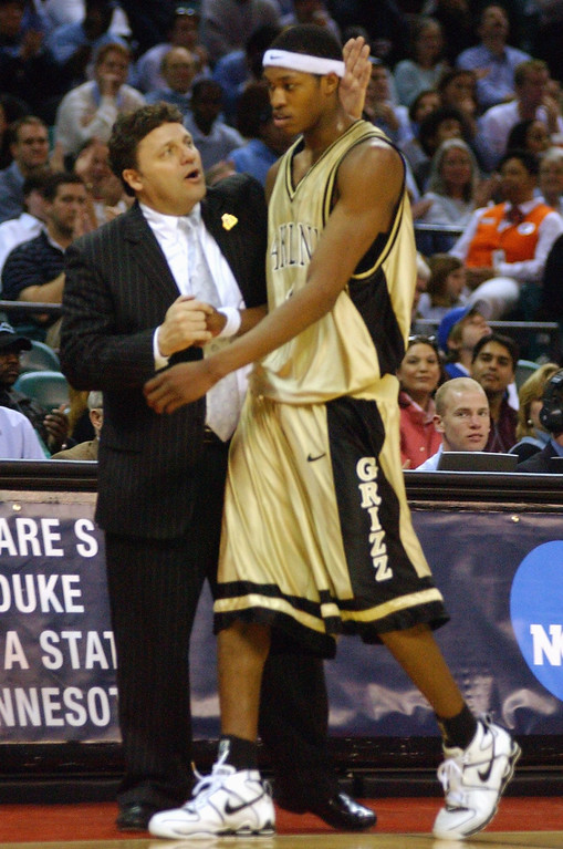 Description of . Oakland University men's basketball head coach Greg Kampe, left, congratulates Rawle Marshall for his efforts as Marshall is taken out of the game during the final minutes of their game against North Carolina during first half action, Friday, March 18, 2005, at the Charlotte Coliseum in Charlotte, NC.  Oakland lost to North Carolina, 96-68.