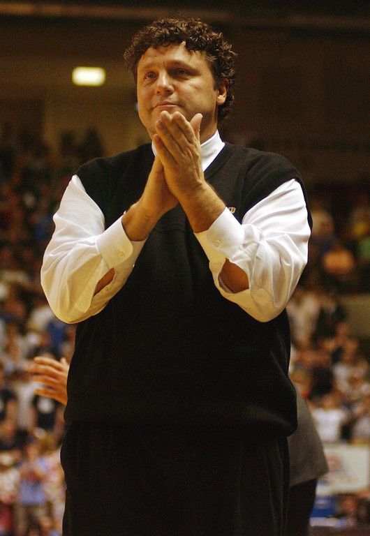 Description of . Oakland University men's basketball head coach Greg Kampe cheers on his team as they played Oral Roberts for the Mid-Continent Conference Championship, Tuesday, March 8, 2005, at the John Q. Hammons Arena in Tulsa, OK.  Oakland defeated Oral Roberts, 61-60, and won a spot in the NCAA tournament.