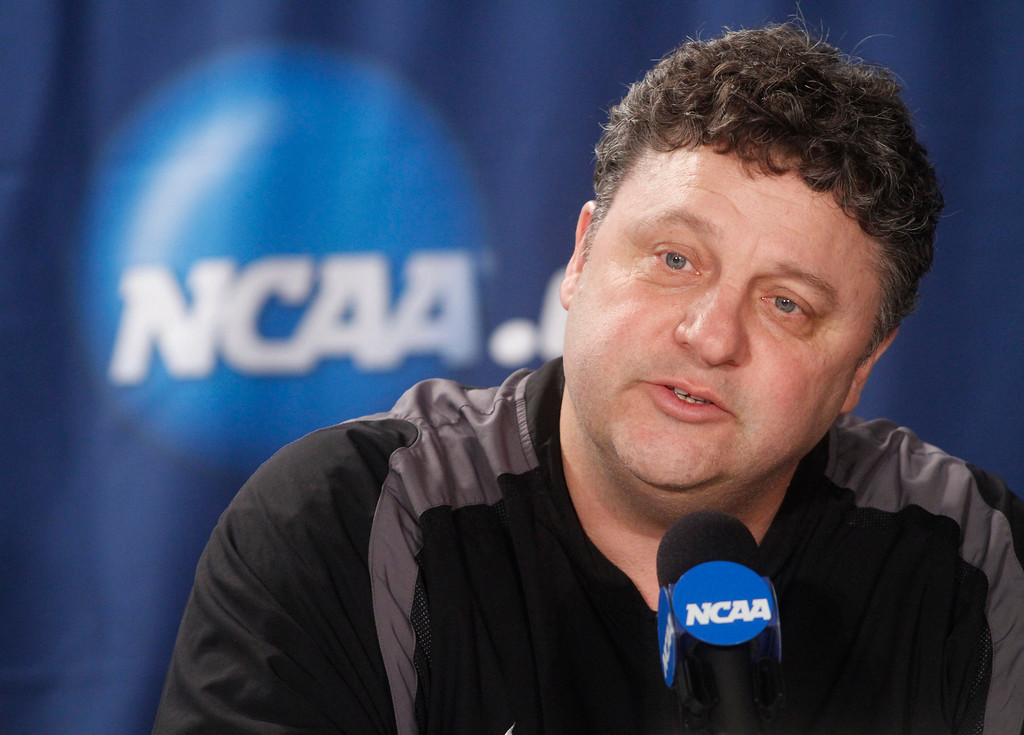 Description of . FILE -  In this March 17, 2011 file photo, Oakland, Mich., University head coach Greg Kampe speaks during a news conference at the West regional second round NCAA college basketball tournament in Tulsa, Okla. Oakland University is hoping the Horizon League sees the Golden Grizzlies as a fit to fill the void created last week when Butler announced plans to join the Atlantic 10. (AP Photo)