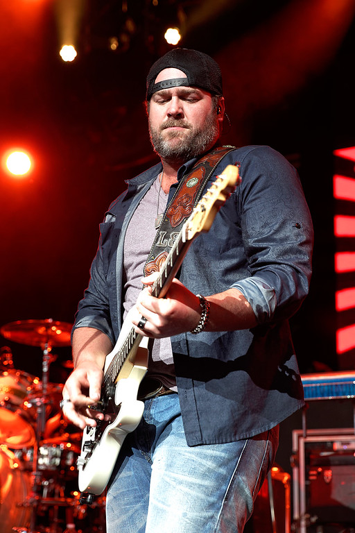 Description of . Lee Brice warms up the crowd before Luke Bryan performs on June 18, 2014, at DTE Energy Music Theatre. Photo by Ken Settle
