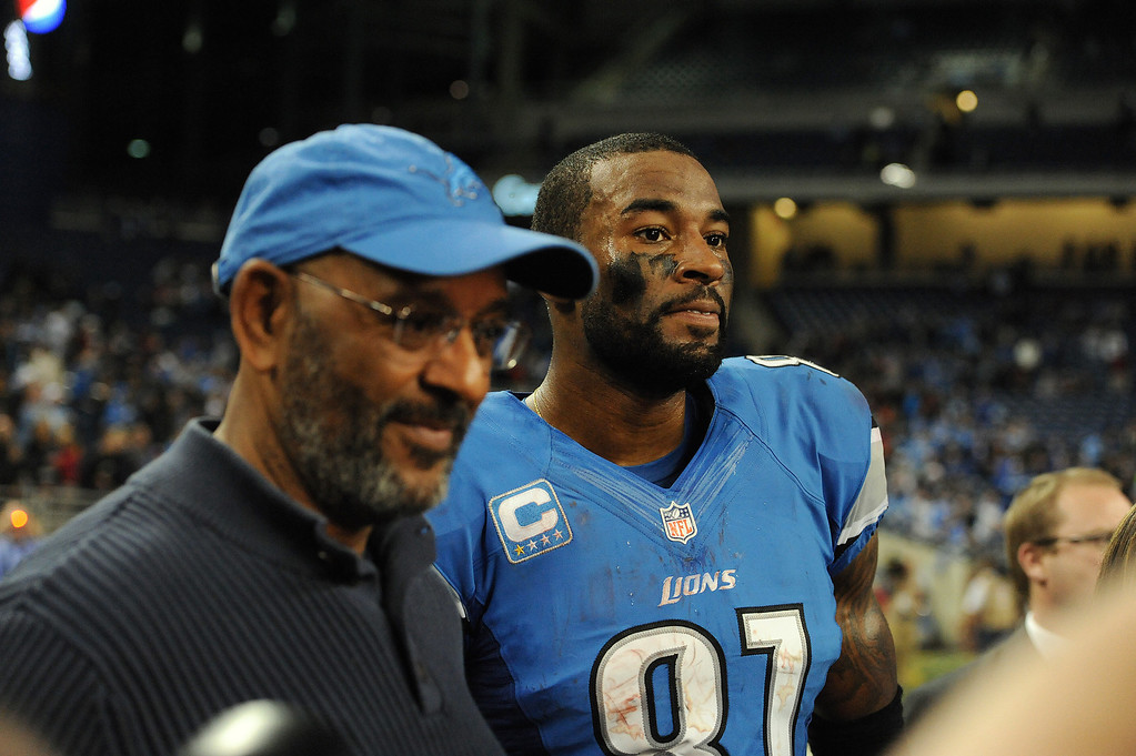 . Detroit Lions wide receiver Calvin Johnson (81) stands with his father, Calvin Johnson Sr. after his team lost to the Atlanta Falcons, 31-18.  Photo taken on Saturday, December 22, 2012, at Ford Field in Detroit, Mich.  (Special to The Oakland Press/Jose Juarez)