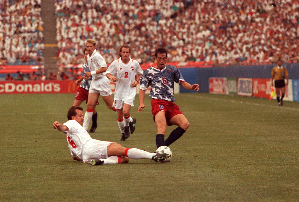 Description of . (FILE PHOTO)-- U.S. and Swiss soccer players squaring off in the first-ever World Cup game played on natural gas at the Pontiac Silverdome in 1994.