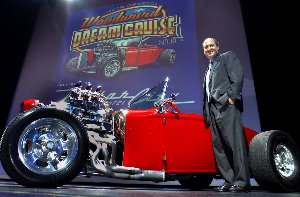 Description of . Tony Michaels, Executive Director of the Woodward Dream Cruise, next to the 1931 Ford Roadster, owned by Jimmy George, of Waterford and featured in this year\'s logo, at a press conference at the Motor City Casino in Detroit. Michaels announced that the casino will be a main presenter at the event this August.