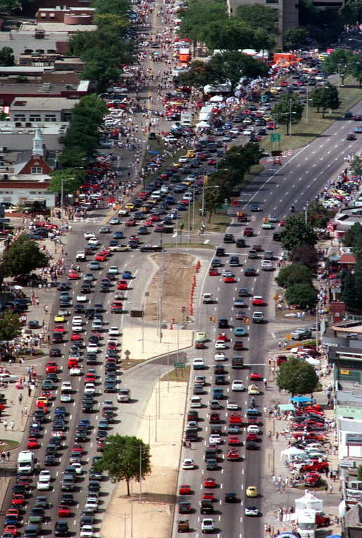 Description of . Aerial view, with southbound cars on left side of photo, of Birmingham, Mich., during the Dream Cruise, Saturday, August 21, 1999.