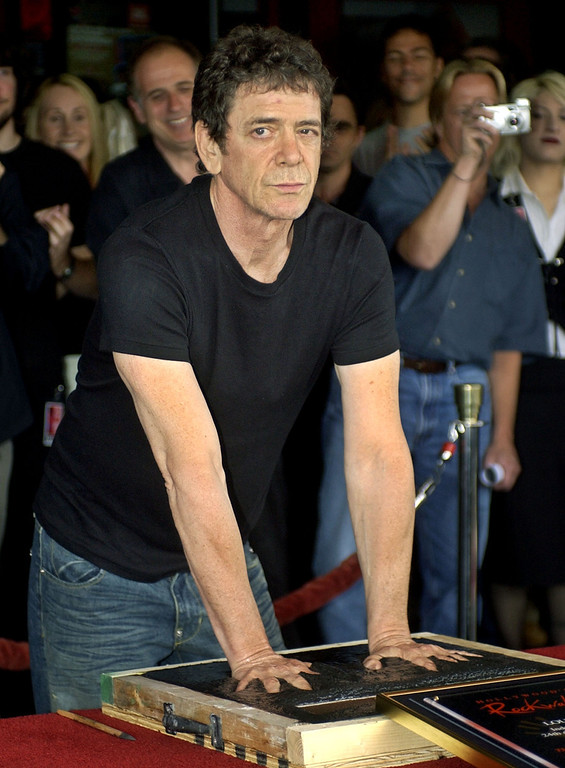 Description of . FILE - In a June 24, 2003 file photo, music icon Lou Reed has his hands imprinted as supporters cheer in the background as he is inducted into Hollywood's Rockwalk, in the Hollywood section of Los Angeles. Punk-poet, rock legend Lou Reed is dead of a liver-related ailment, his literary agen said Sunday, Oct. 27, 2013. He was 71.(AP Photo/Ric Francis, File)