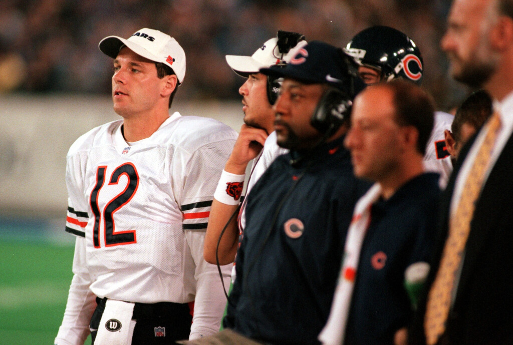 . Chicago Bears starting quarterback Eric Kramer (12) watch the game from the sideline due to an injury that prevented him from starting Sunday night\'s game at the Pontiac Silverdome against the Detroit Lions.