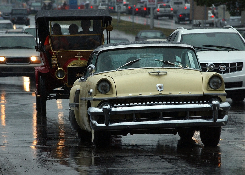 . Steady rain fell much of the day during the 16th Annual Woodward Dream Cruise in Royal Oak. (Oakland Press Photo/Vaughn Gurganian)