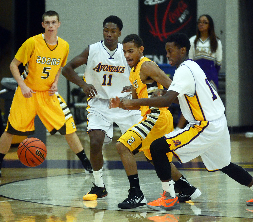 Description of . Rochester Adams #2 Akhemji Williams (center) goes after a loose ball along with Avondale's #11 Chris Barton and #12 Daequan Terrell during their game at Avondale High School, Tuesday December 11, 2013. (Vaughn Gurganian-The Oakland Press)