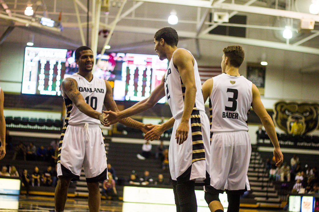 Description of . Oakland players congratulate #10 Duke Mondy after a lay-up. Photo by Dylan Dulberg