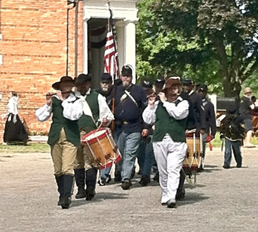 Description of . the Oakland County Pioneer and Historical Society's 43rd Annual Summer Ice Cream Social on the grounds of Pine Grove Museum in Pontiac includes cake and ice cream as well as a Civil War re-enactment. Photo courtesy of Linda Porter