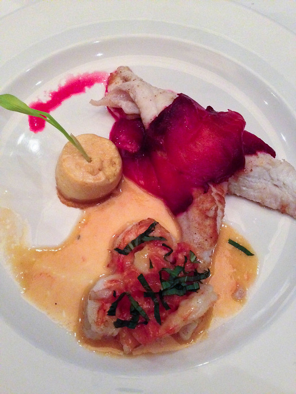 Description of . Expertly cooked Dover sole is topped with thin slices of beet-cured salmon at The Stand Gastro Bistro in Birmingham. (Photo by Lori Yates)