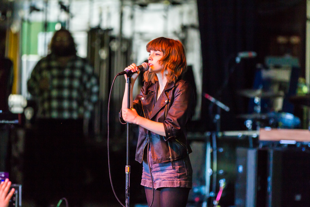 Description of . Chvrches, an Electropop Group from Glasgow, plays to a packed crowd at Laneway Festival.