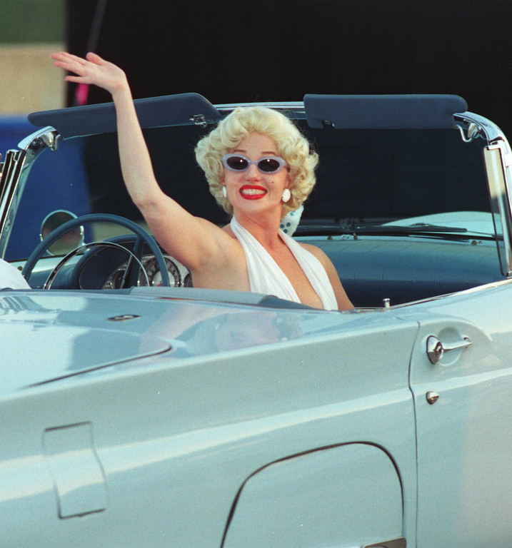 Description of . A Blast from the past. Marilyn Monroe (local impersonator) arrives at one of two rooftop parties in Birmingham. Society Dream Cruise related.