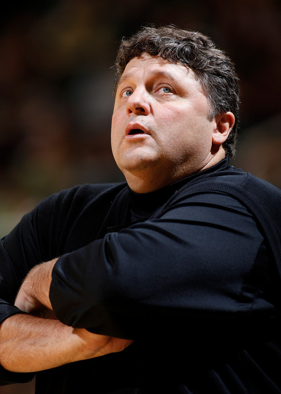 Description of . Oakland Michigan coach Greg Kampe is shown on the bench during the first half of an NCAA college basketball game against Michigan State, Thursday, Dec. 10, 2009, in East Lansing, Mich. Michigan State won 88-57. (AP Photo/Al Goldis)