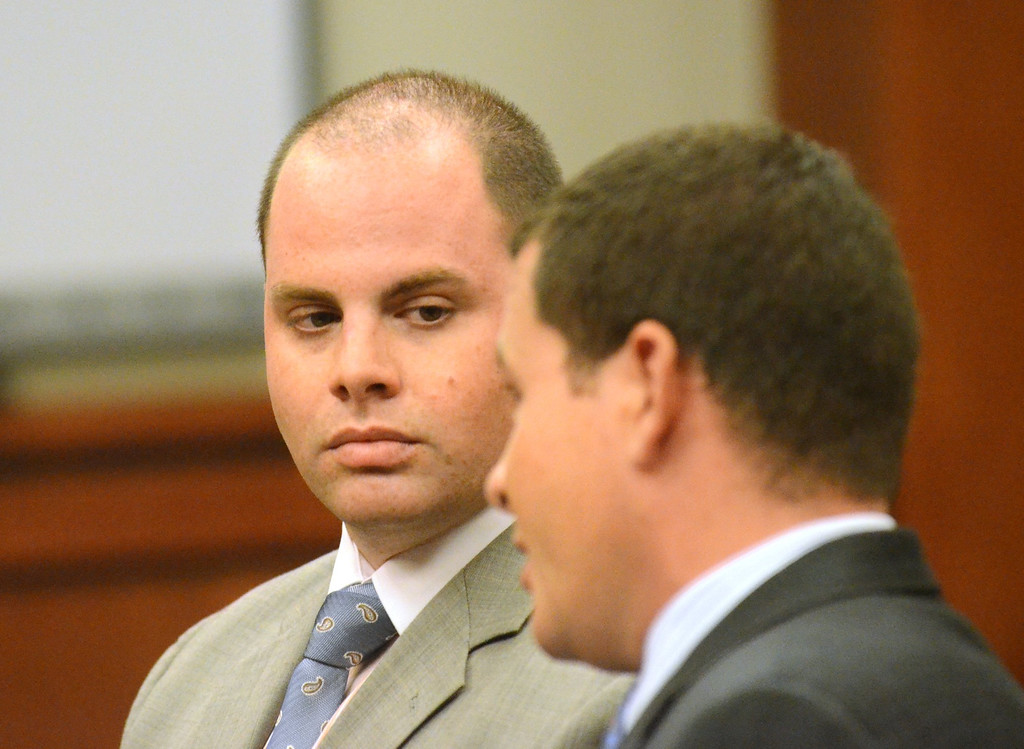 Description of . ***WITH VIDEO*** Anthony Prainito, 31 of Royal Oak, left, looks to his lawyer Joshua Nucian in Judge Lisa Asadoorian 52-2 District Court in Rochester Hills.  Prainito was charged with three misdemeaner counts following his car accident that injured Oakland County Executive L. Brooks Patterson and his driver on August 10 in Auburn Hills.    Wednesday, August 22, 2012.  The Oakland Press/TIM THOMPSON