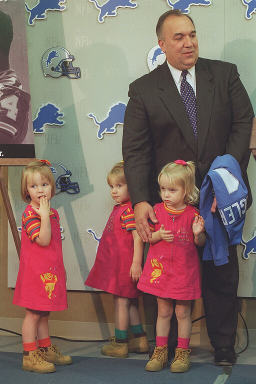 """. Governor John Engler with triplets Madeleine, Margaret and Hannah during the Detroit Lions \""""Fatherhood is Forever\"""" press conference."""