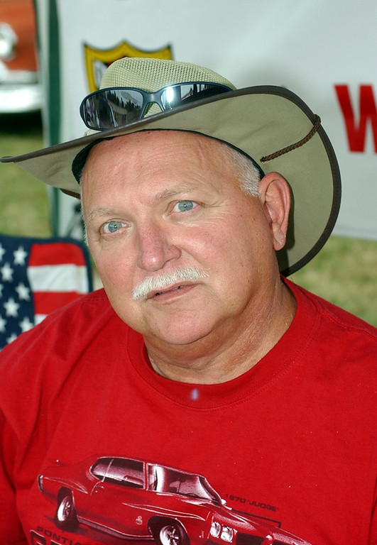 Description of . Mike Woody of Goodrich comments on the price of gad during Friday\'s Woodward Dream Cruise.