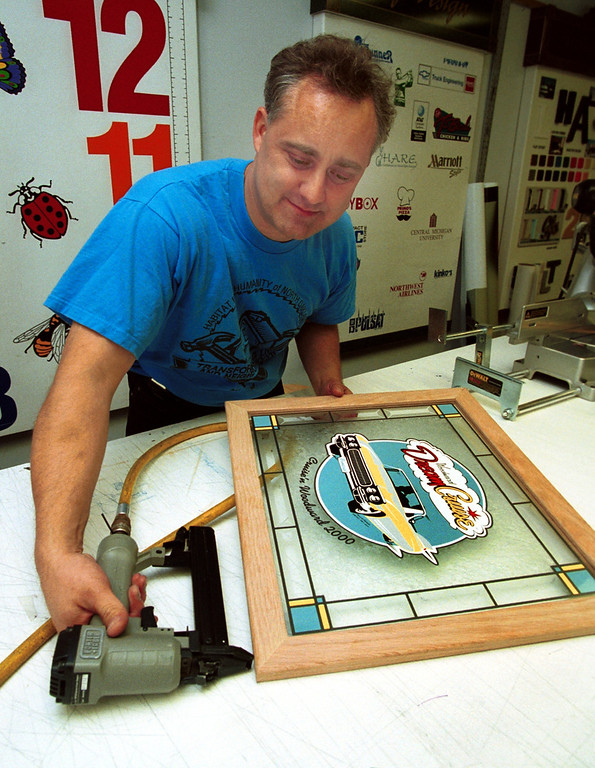 Description of . Rick Petrella works on a Woodward Dream Cruise stained glass work at his office in Troy, Mich., Thursday, August 3, 2000.