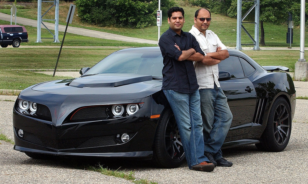Description of . (left) Ajmal Ahmad and Faisal Ahmad, both of West Bloomfield but not related, next to their 2010 Firebreather they will drive in this year\'s Dream Cruise.