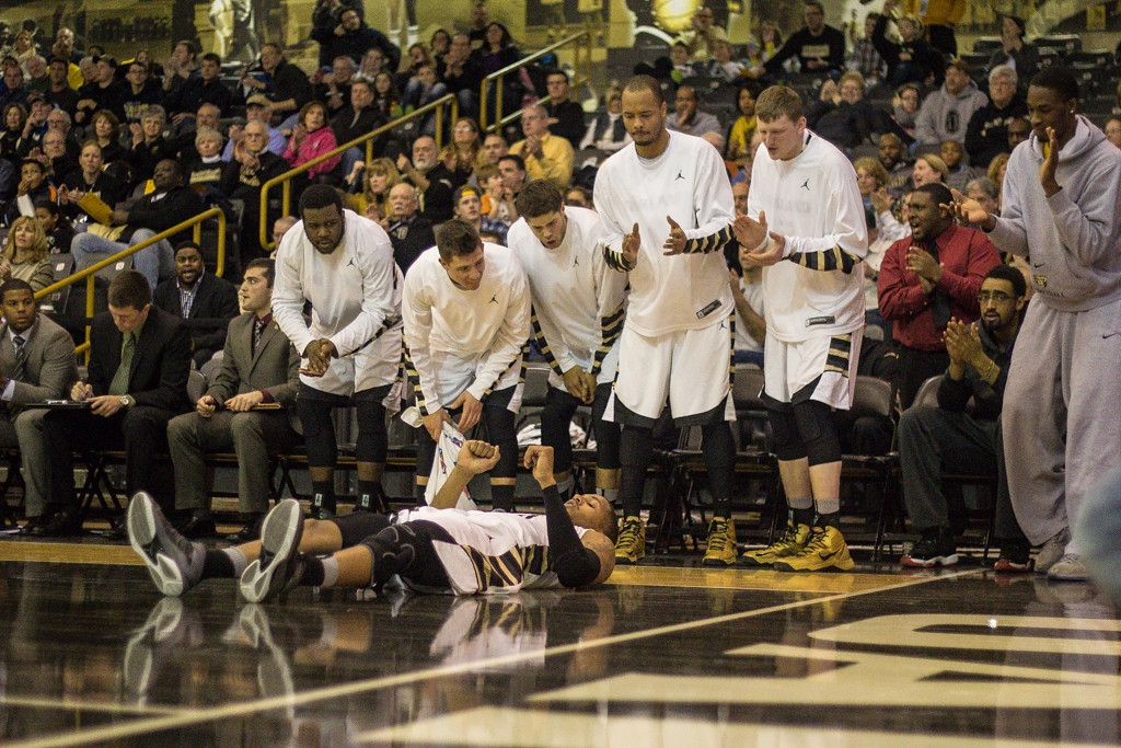 Description of . Teammates react as Mondy lands after shooting a lay-up. Photo by Dylan Dulberg/The Oakland Press