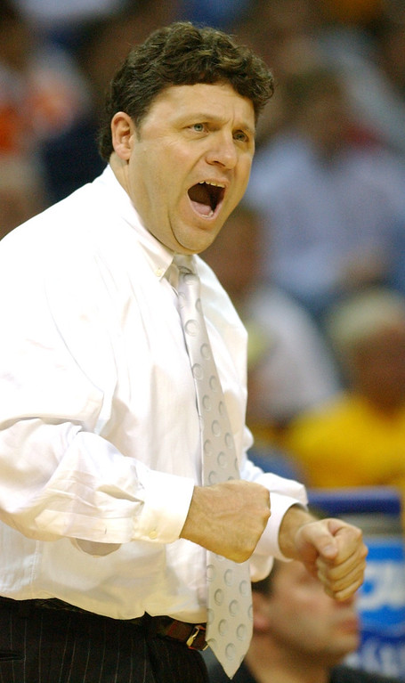 Description of . Oakland University men's basketball head coach Greg Kampe yells instructions to his team as they played North Carolina during first half action, Friday, March 18, 2005, at the Charlotte Coliseum in Charlotte, NC.  Oakland lost to North Carolina, 96-68.