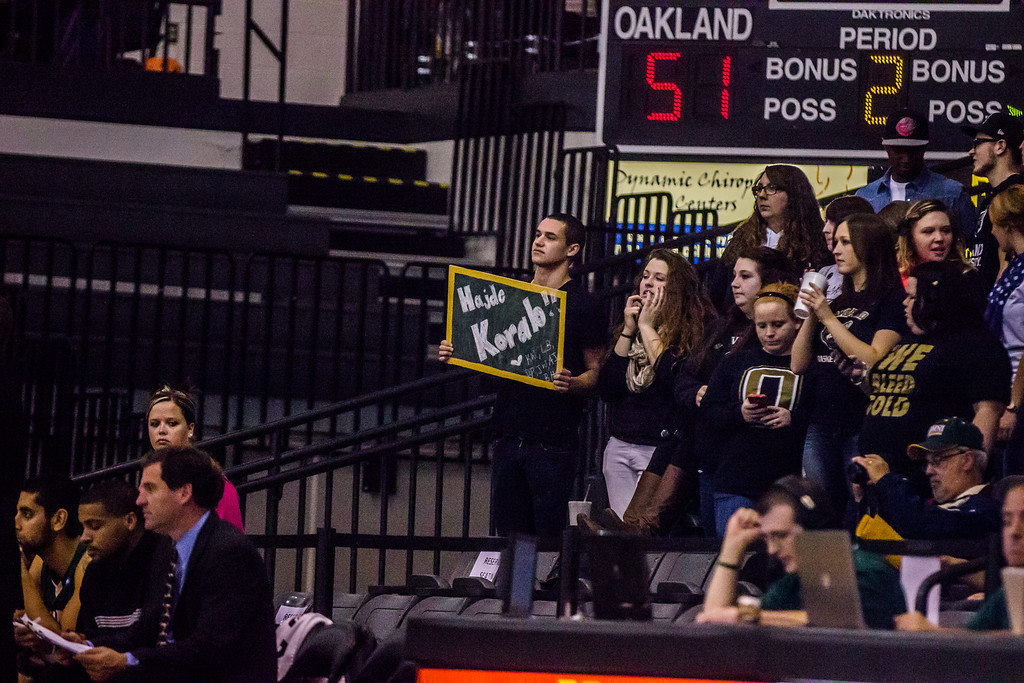 Description of . Oakland University's Grizz Gang student section came out to support the team at their preseason exhibition against Tiffin Tuesday, Oct. 29, 2013 at the Athletics Center O'rena. Photo by Dylan Dulberg